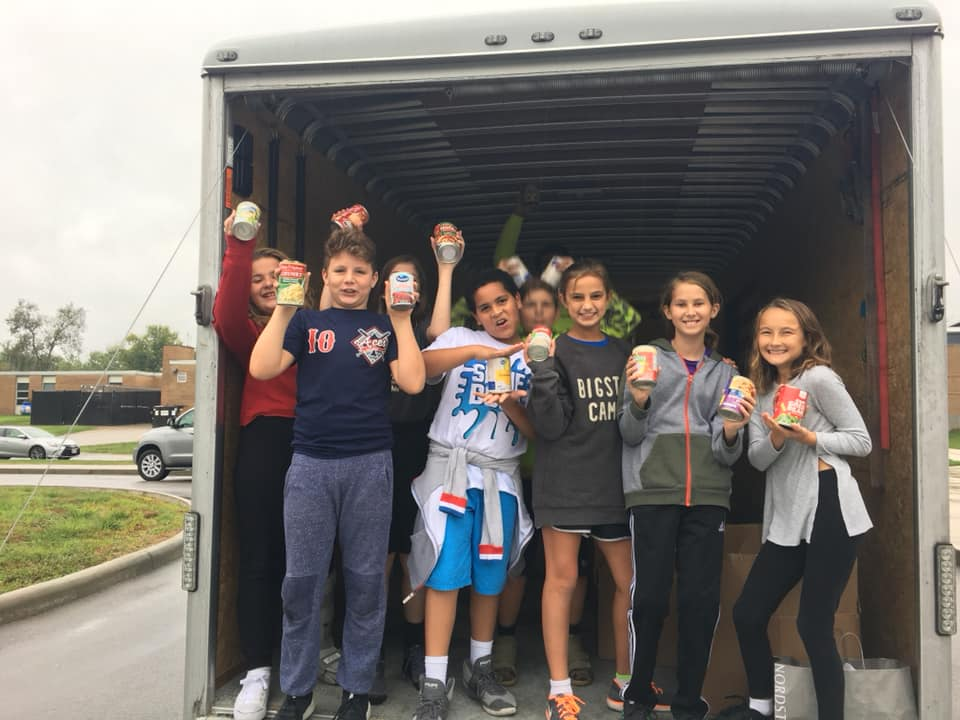 Forest Hills students volunteering with food delivery
